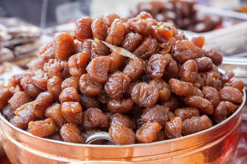 A marron glacé plural marrons glacés is a confection, originating in southern France and northern Italy. Consisting of a chestnut candied in sugar syrup stock photography