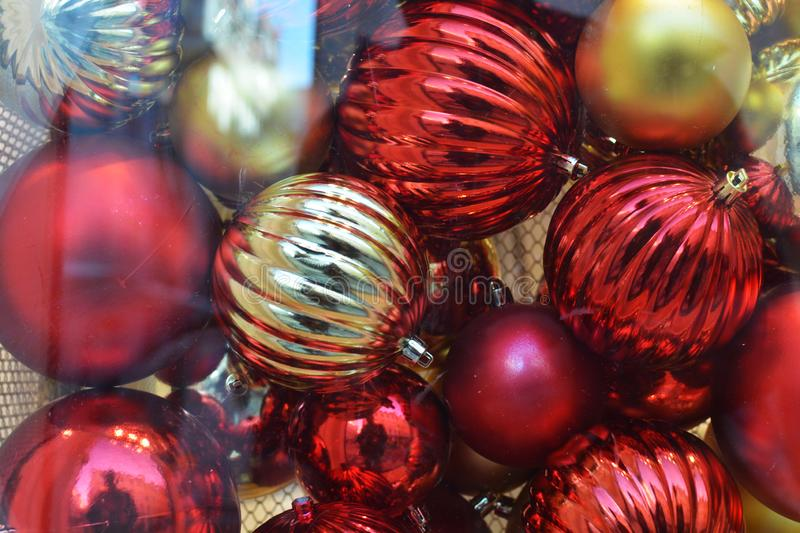 Marry Christmas and Happy New Year. New Year background. Balls. Happiness. Red gold. Glass. Reflections. Celebrate. Holiday. stock photography
