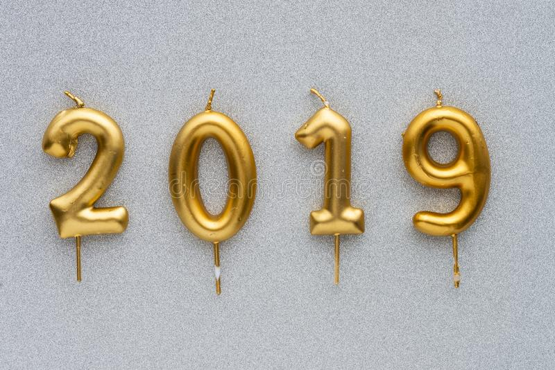 Merry Christmas and happy New Year 2019 layout. Gold candles numbers 2019 royalty free stock photo