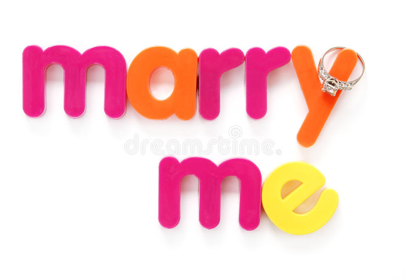 Marry me. Plastic letters spell marry me with a diamond ring royalty free stock photography