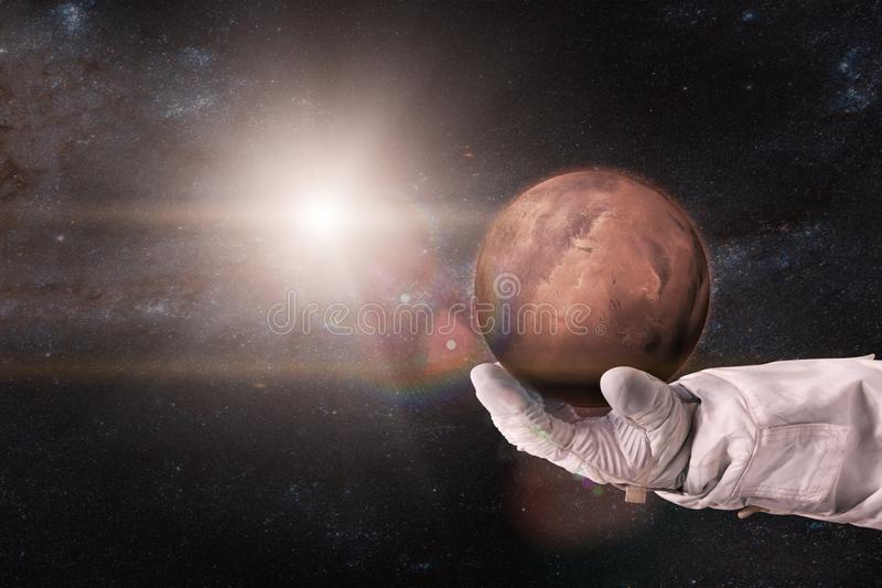 Mars in the hands of astronaut. Elements of this image furnished by NASA royalty free stock images
