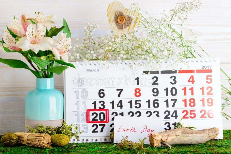 20 mars jour de terre sur le calendrier images stock