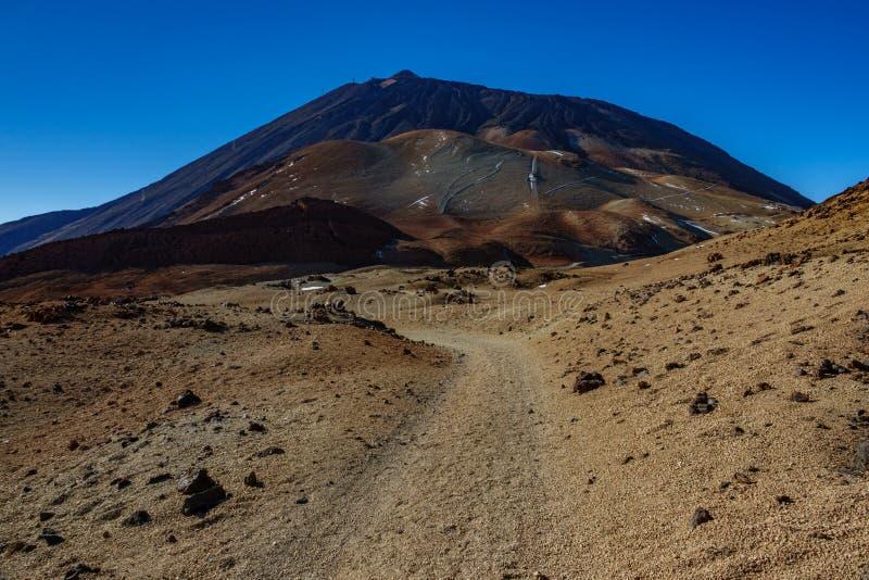 Mars landscape with tracks towards Teide volcano peak. Wide angle of Mars landscape with tracks towards Teide volcano peak stock photos