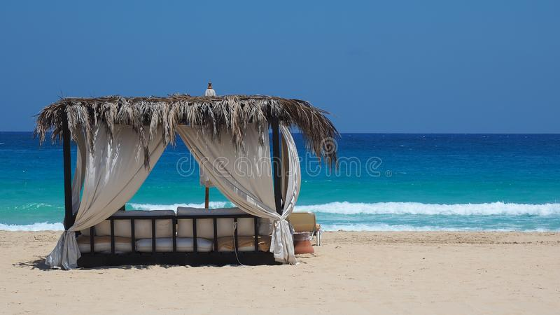 Marsa Matruh, Egypt. Elegant gazebo on the beach. Amazing sea with tropical blue, turquoise and green colors. Relaxing context. Nobody on the beach. Fabulous royalty free stock photography