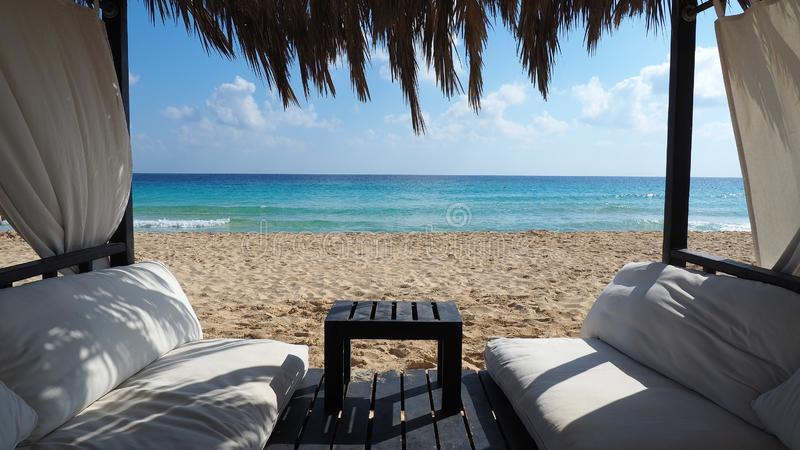 Marsa Matruh, Egypt. Elegant gazebo on the beach. Amazing sea with tropical blue, turquoise and green colors. Relaxing context. Nobody on the beach. Fabulous stock image