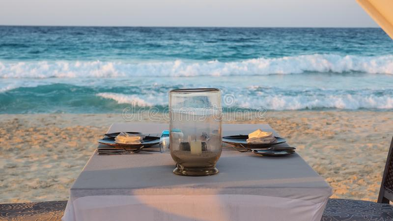 Marsa Matruh, Egypt. Gazebo on the beach with table set. Candle on table. Relaxing context. Nobody on the beach. Blue sea on the back. Fabulous holidays royalty free stock photo