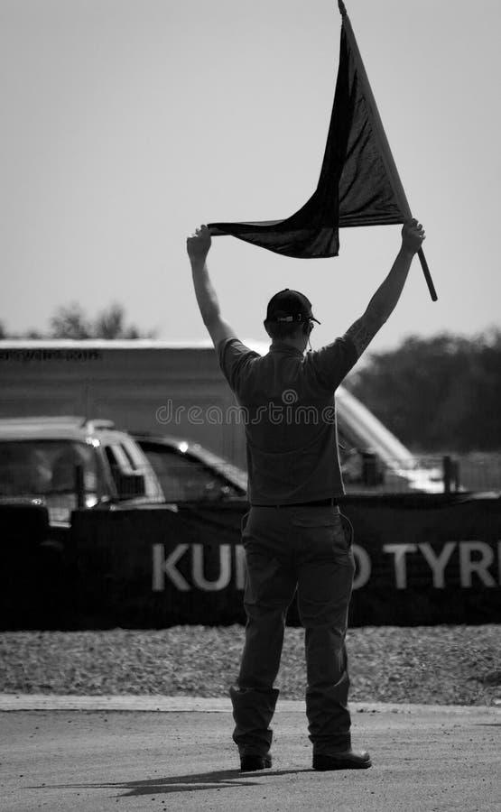 Marschall mit Flagge lizenzfreie stockfotografie