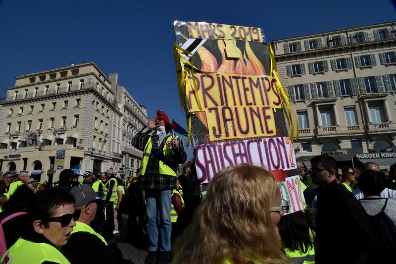 Protesters with yellow vests in France. Marseille, France - February 23, 2019 : Demonstrators with yellow vests `gilets jaunes` in french protest against the royalty free stock photography