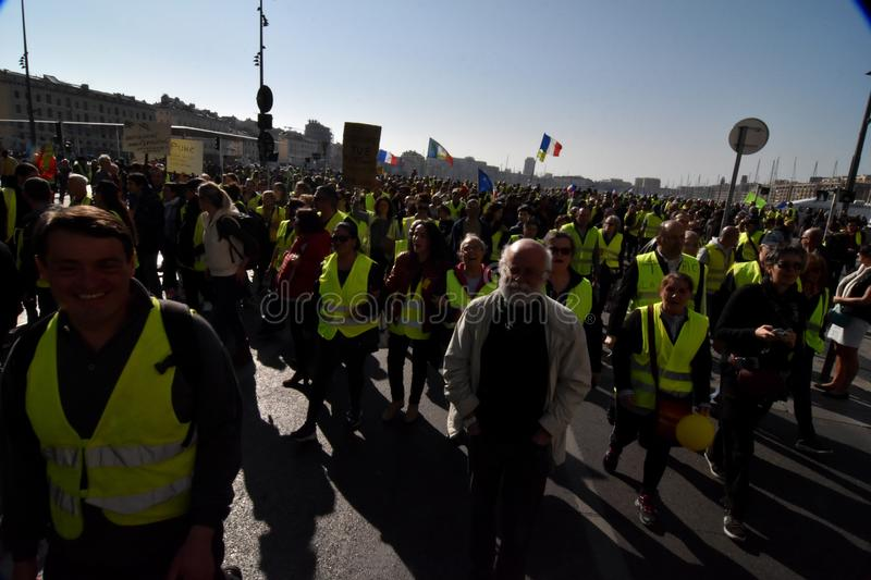 Protesters with yellow vests in France. Marseille, France - February 23, 2019 : Demonstrators with yellow vests `gilets jaunes` in french protest against the royalty free stock image