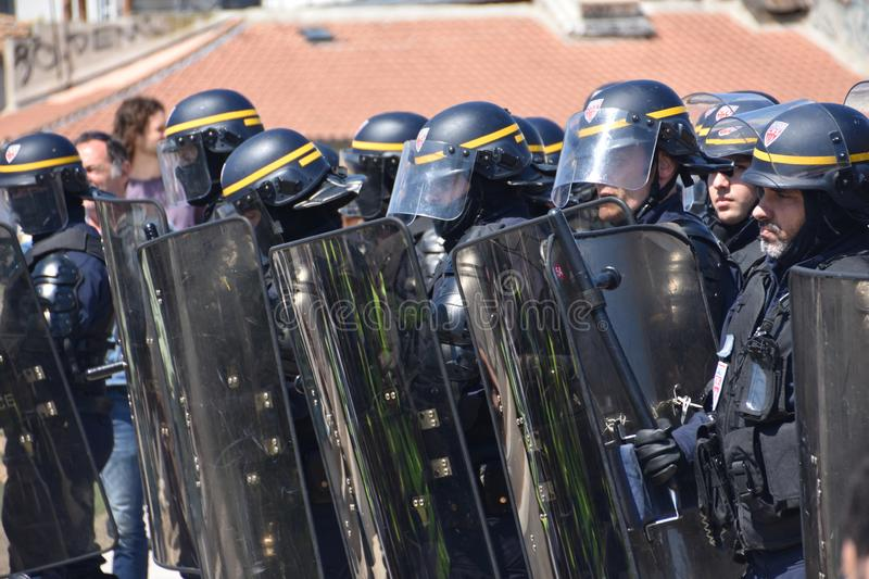 Helmeted police officers. Marseille, France - May 01, 2019 : Helmeted police officers photographed from behind during a protest stock photos