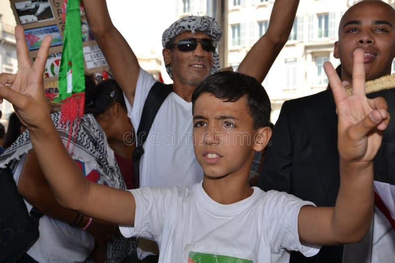 Marseille, Frankrijk - Augustus 9, 2014: De protesteerder verzamelt zich tijdens een demonstratie royalty-vrije stock afbeelding