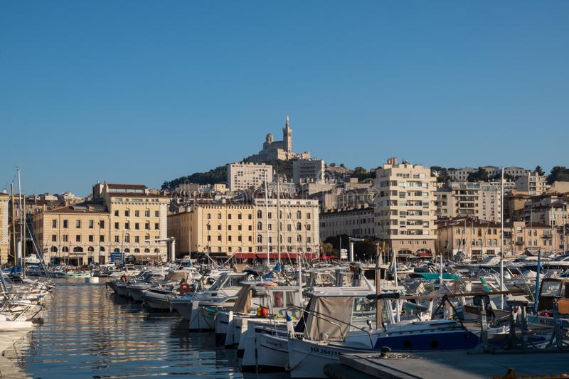 Marseille Vieux Port, France, Summer day. Marseille  city skyline at Vieux Port and Notre-Dame de la Garde Basilica, Marseille, France royalty free stock images