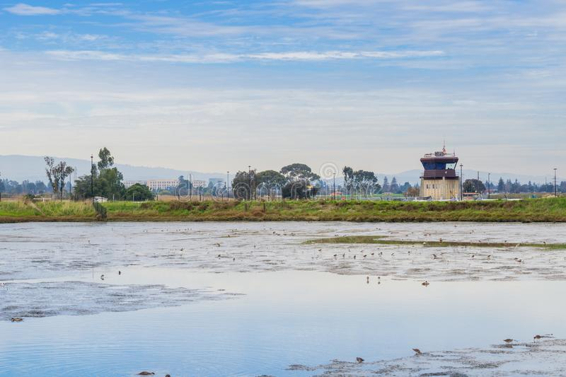 Marsh in baylands park, airport control tower in the background, Palo Alto, San Francisco bay area, California stock photos