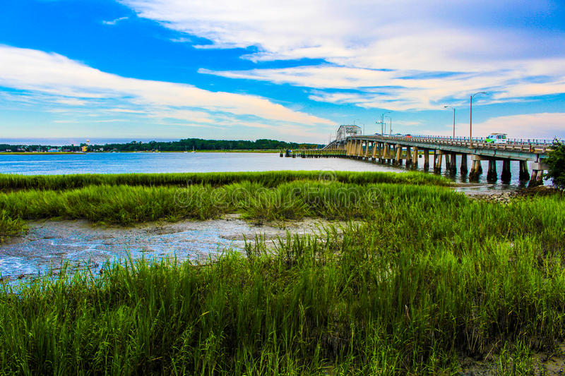 Marsh with a river and bridge royalty free stock photo
