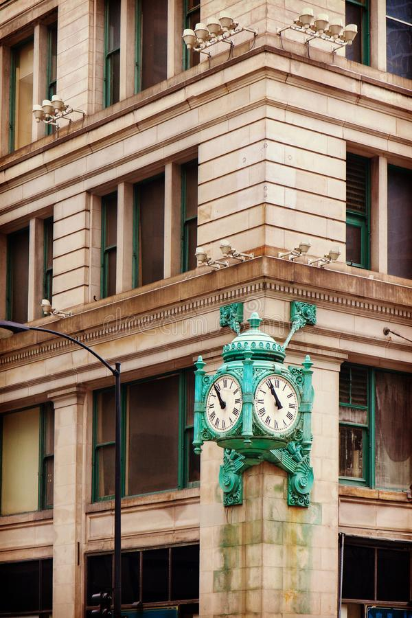 Marshall Field`s clock on State Street in Chicago, USA royalty free stock photos