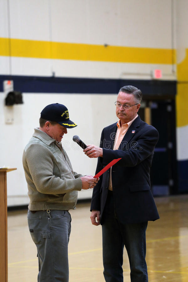 Marshalltown, Iowa, USA. May 11, 2017. Rod Blum town hall. Republican Representative Rod Blum of Iowa`s First Congressional District listens to a consitituent at stock images