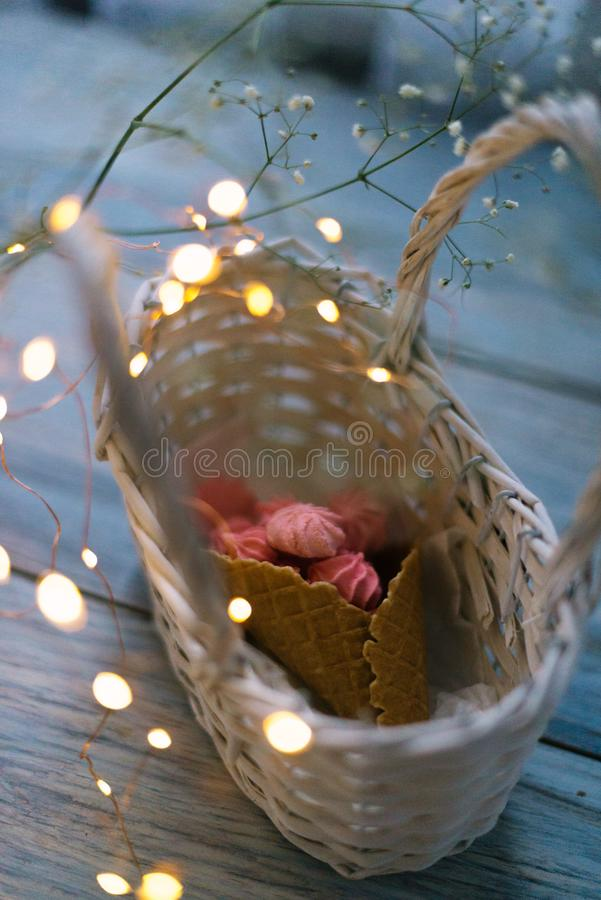 Download Marshmallow In A Basket With A Horn With Garlands Stock Photo - Image of lightbulb, green: 111619744