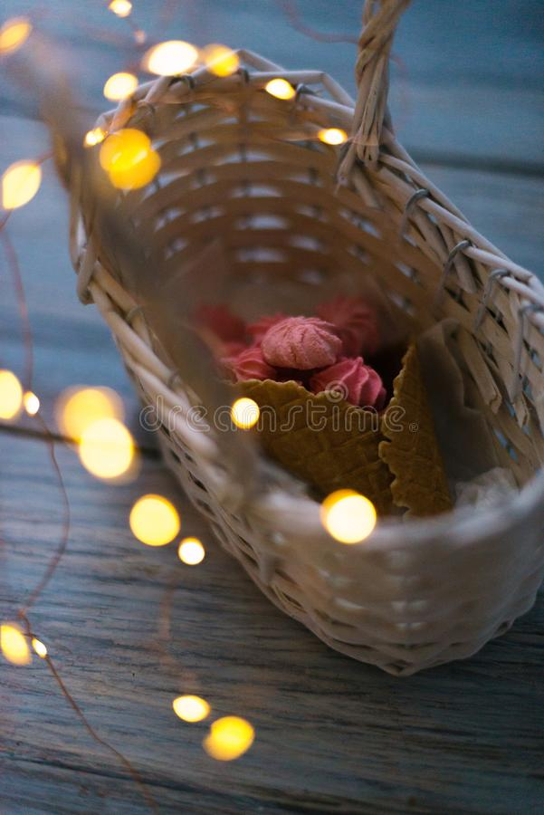 Download Marshmallow In A Basket With A Horn With Garlands Stock Photo - Image of horizontal, breakfast: 111619966