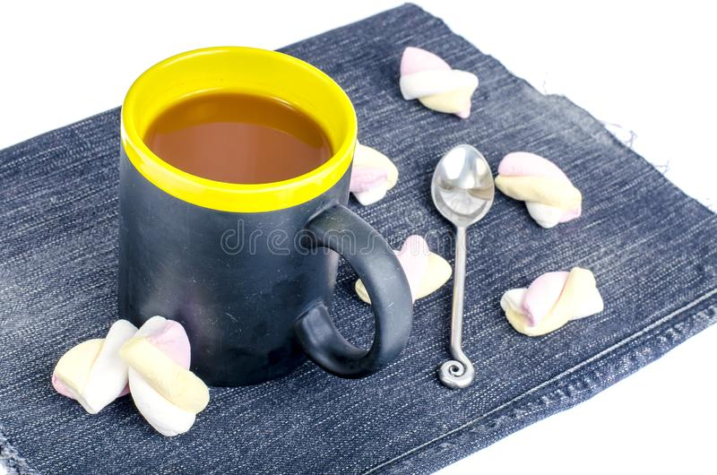 Marshmallow in cocoa drink in black cup. Studio Photo stock images