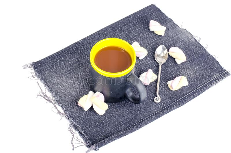 Marshmallow in cocoa drink in black cup. Studio Photo royalty free stock image