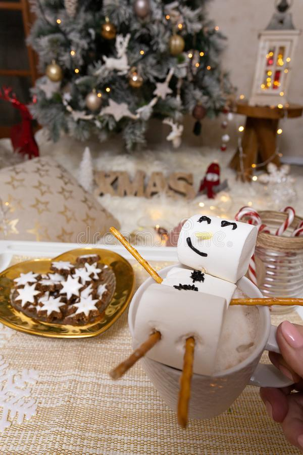 Marshmallow snowman float in hot chocolate at Christmas stock photo