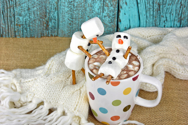 Marshmallow snowmen with hot chocolate drink stock photos