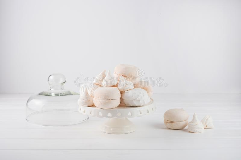 Marshmallows beige and white stacked on a cake stand royalty free stock photo