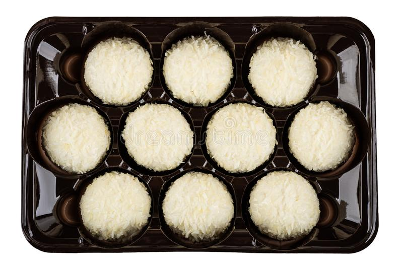 Marshmallows with coconut shaving in container isolated on white. Top view. Marshmallows with coconut shaving in brown plastic container isolated on white stock photo