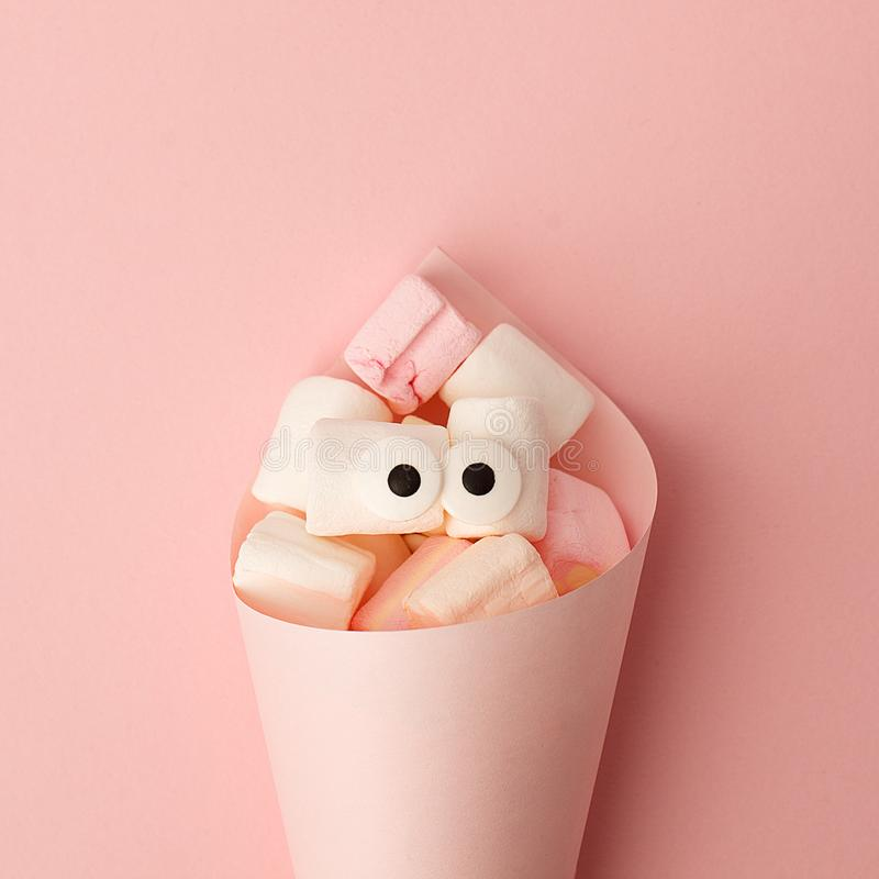 Marshmallows with eyes. Funny kawaii emoji face. Cute cartoon character. Minimal summer flat lay design. Sweet food. Pink. Background, monochrome concept stock photo