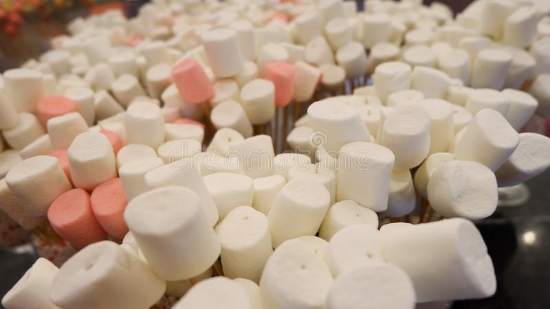 Marshmallows on standing stick. Close up royalty free stock photography