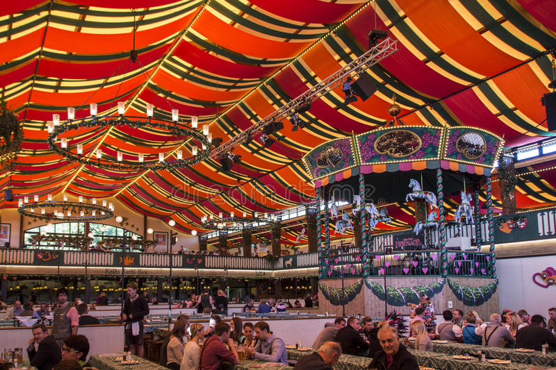 Marstall tent at Oktoberfest in Munich, Germany, 2015. Inside the Marstall beer tent with people celebrating Octoberfest royalty free stock photography