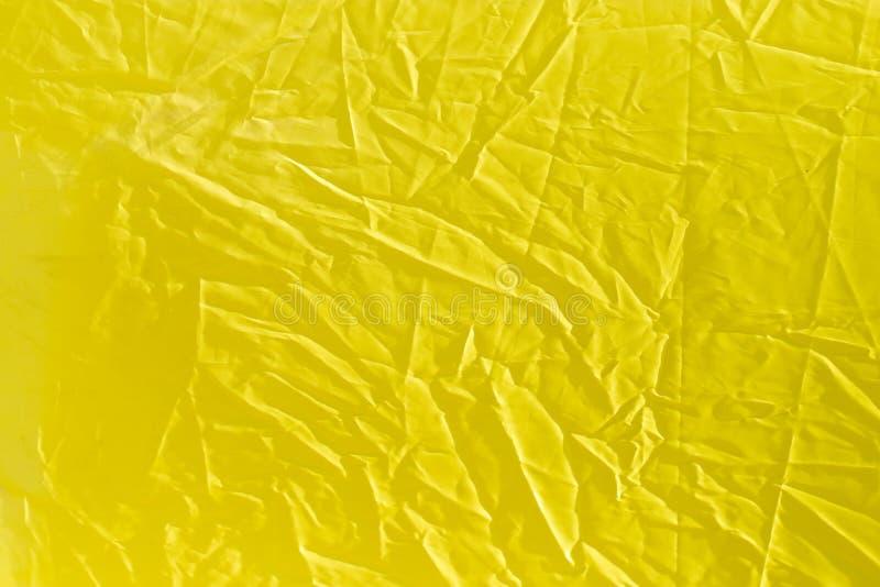 Marszczący żółty płótno jako tło zdjęcie stock