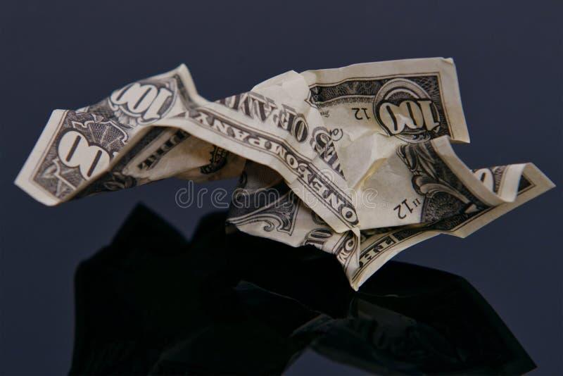 Marszczący banknot z świeceniem na czerni obrazy stock