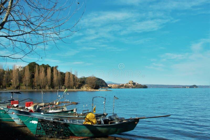 Marta village on Bolsena lake. View of the fishermen burg of Marta on Bolsena lake, Lazio, Italy royalty free stock images