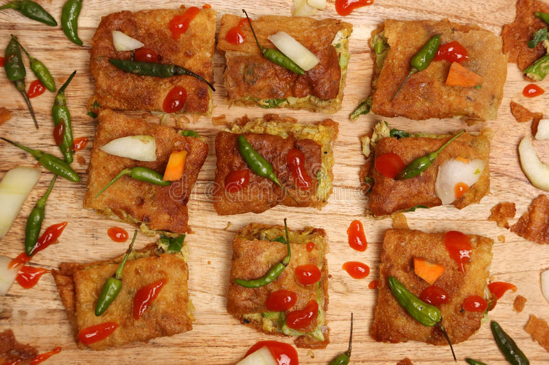 Martabak. Top view of veggie martabak with chili peppers and hot souce royalty free stock photos