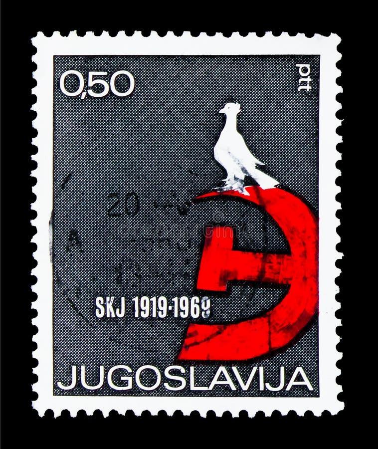 Marteau et faucille avec la colombe de paix, association du Yougoslave Co photographie stock