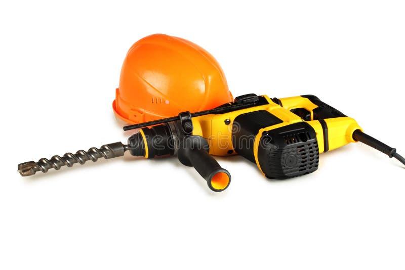 Martello pneumatico rotatorio professionale e un casco della costruzione immagini stock libere da diritti