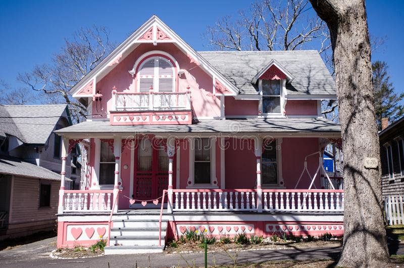 Pink Carpenter Gothic Cottages with Victorian style, gingerbread trim in the village of Oa. MARTHA`S VINEYARD, MA: Pink Carpenter Gothic Cottages with Victorian stock photo