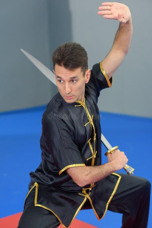Martial arts expert using sword. Martial arts expert using a sword stock photo