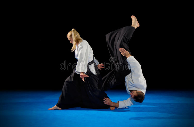Martial arts fighters isolated. On black royalty free stock photo