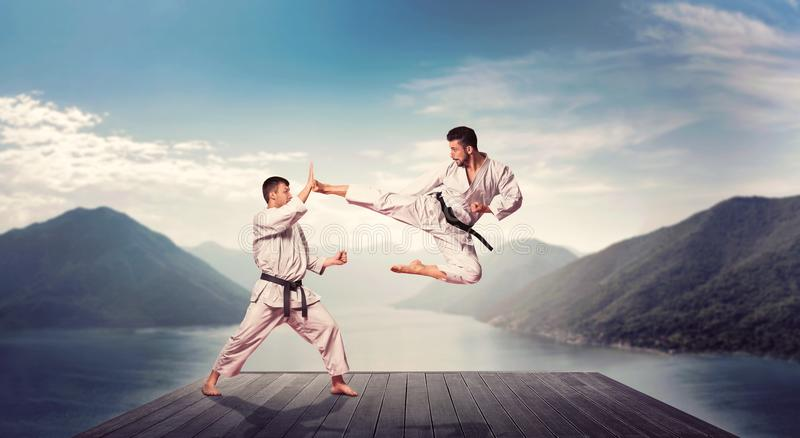 Martial arts, kick in jump, training on the pier stock photos
