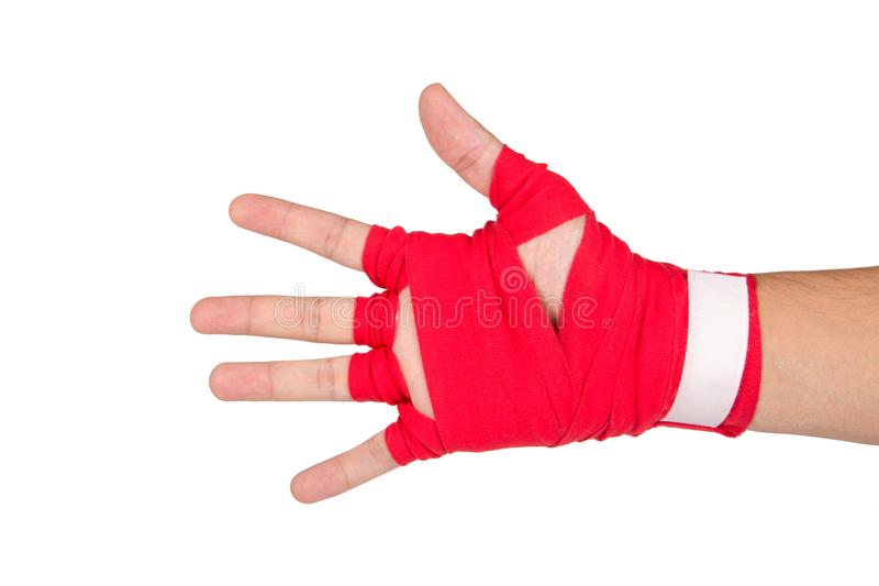 Martial Arts Man Hand with Red Boxing Wraps. Close up detailed view of mixed martial arts athlete man hand with red boxing wraps, ready for fighting, exercising stock photo