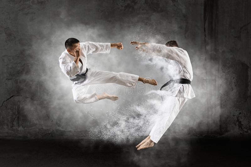 Two male karate fighting royalty free stock photo