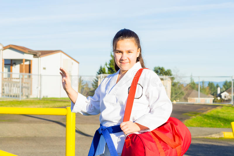 Martial Arts Student Waves Hello stock photo
