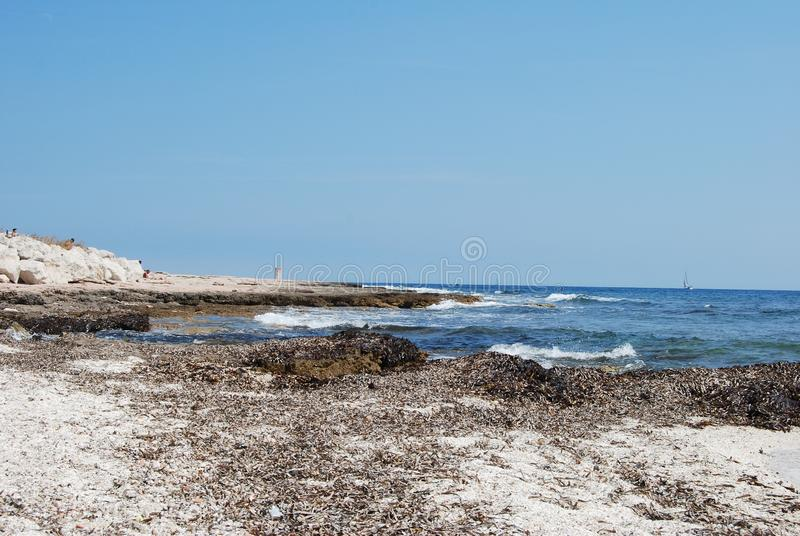 Martigues, France - July 6 2011 : Beautiful beach with the sea on a sunny summer day.  royalty free stock images