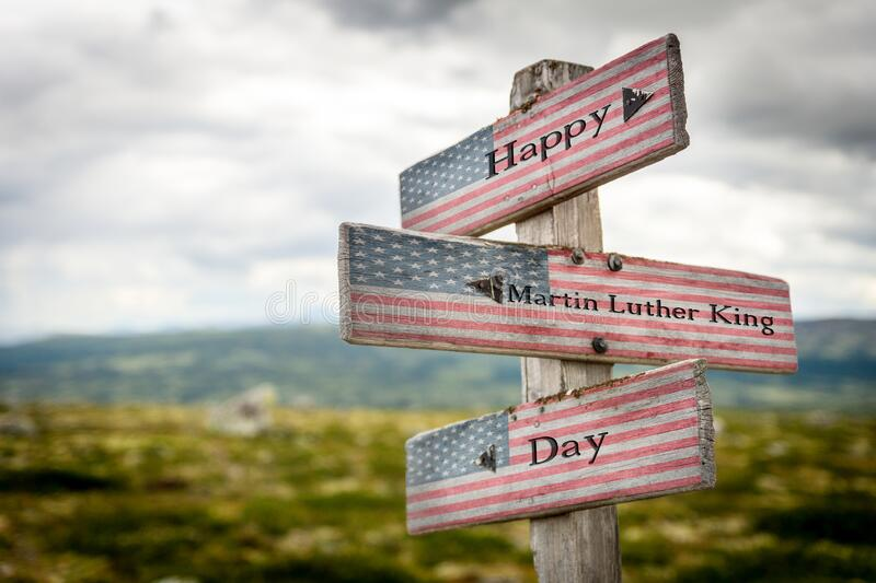 Martin luther king text on wooden american flag signpost outdoors. In nature stock images