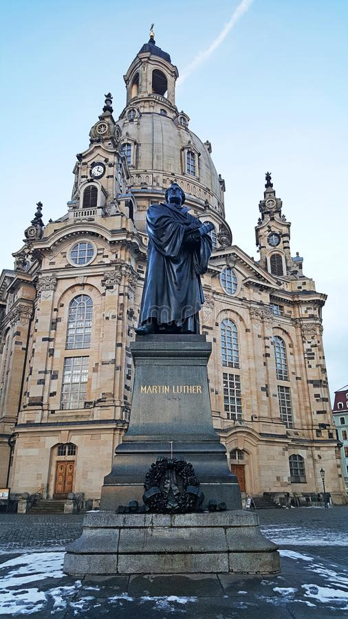 Martin luther monument in front of the Frauenkirche cathedral royalty free stock photography
