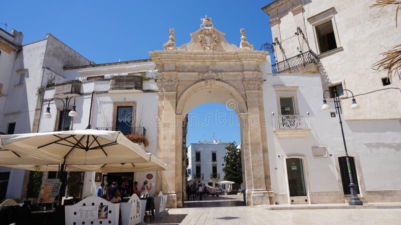 MARTINA FRANCA, ITALY - JULY 31, 2017: view of Santo Stefano gate also known Archway Sant`Antonio, Martina Franca, Italy stock photography