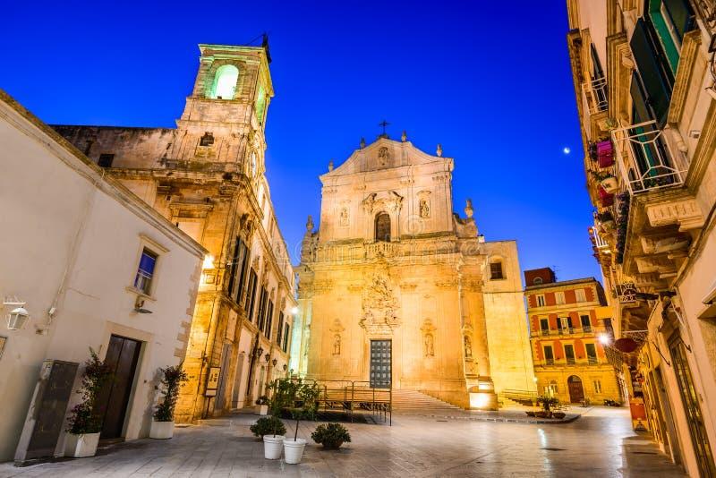 Martina Franca, Puglia, Italy. Martina Franca, Puglia in Italy. Piazza Plebiscito and Basilica di San Martino at twilight stock photography