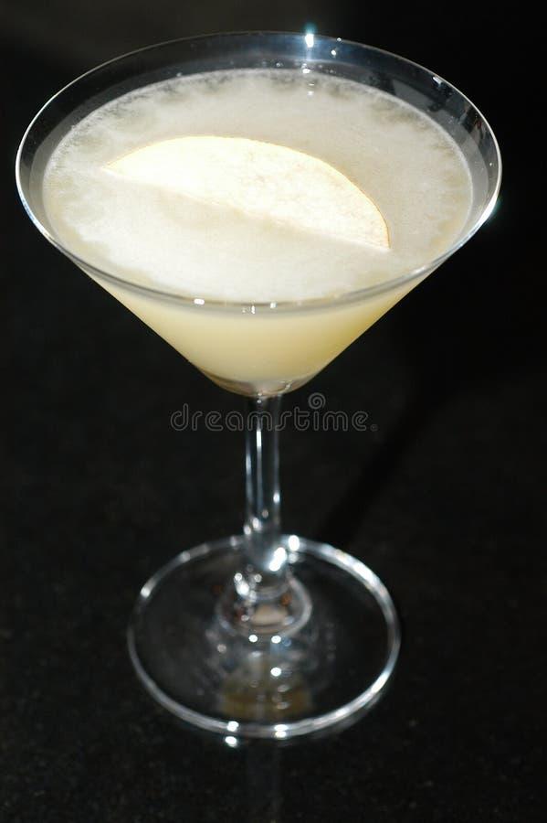 Martini blanc avec la tranche de citron photographie stock